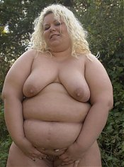 Horny blonde BBW Helga does a striptease outdoors to lure a black guy into lending her his schlong live