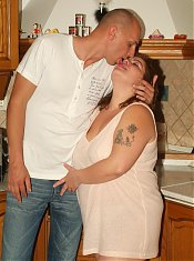 Mindy joins her younger lover in the kitchen to have her fat pussy plugged with a dick