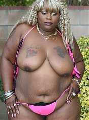 Thunder Katt exposes her massive folds of fat and enormous black ass during a live cam show